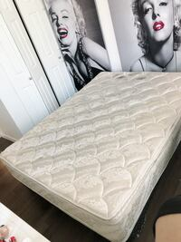 quilted white mattress with white wooden bed frame Vancouver, V6C