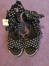 White-and-black polka dot wedged wrap around heeled sandals size 9