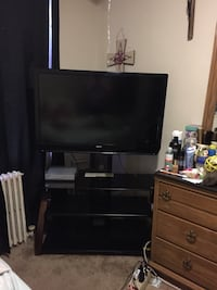 flat screen television with brown wooden TV stand Hyattsville, 20782