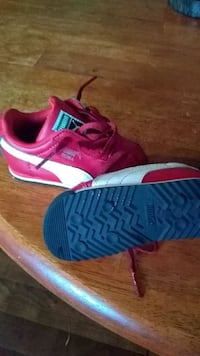 pair of pink-and-black Nike running shoes Jacksonville, 32210