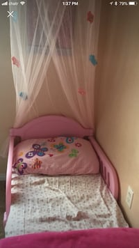 baby's pink and white crib