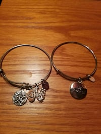 Set of 2 silvertone bangles with charms