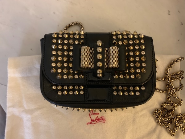 Christian Louboutin Authentic crossbody bag with crystals