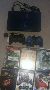 Sony PS2 with two controllers and game cases 33 km