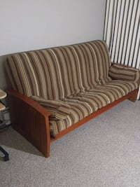brown and white striped fabric sofa