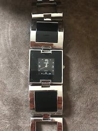 black and silver analog watch Laval