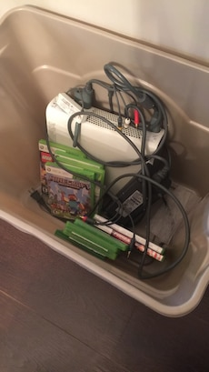 white Nintendo 360 game console and game cases