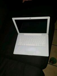 white and black laptop computer Los Angeles, 90037