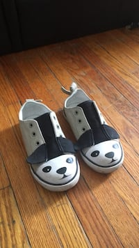 pair of black-and-white slide sandals London, N5Y 3J4