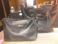 BCBG black leather tote  with insert that clips in with hooks  Duncan
