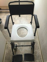 Commode chair with adjustable armrest