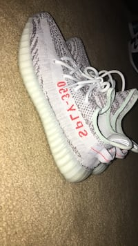 Unpaired white and red adidas yeezy boost 350 v2 53 km