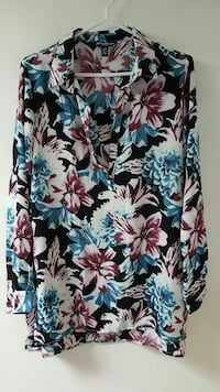 white, black, red, and blue floral blouse
