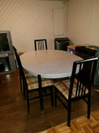 round brown wooden table with four chairs dining set Bois-des-Filion