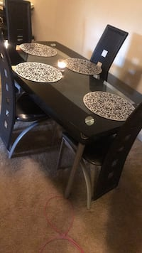 black wooden table with chairs Hyattsville, 20782