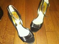 pair of black leather peep-toe heeled sandals Winnipeg, R3A 0L8