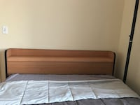 Brown wooden bed frame with queen bed frame