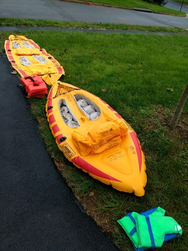 2 Coleman Inflatable kayaks and life vests