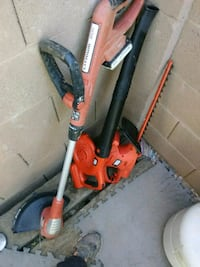 orange and black string trimmer and black and red