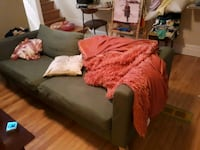 brown wooden bed with red comforter set 537 km