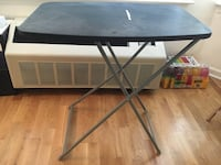 rectangular black folding table
