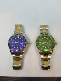 round blue and green Rolex analog watches with silver-and-gold links