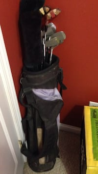 black golf bag with golf clubs