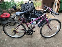 black and purple Next full-suspension mountain bike Austin, 78729