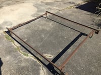 Black metal frame with brown wooden bed frame queen/full. Baton Rouge, 70816