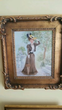 woman in white dress painting with brown wooden frame Montreal, H3R 3L4