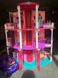 pink and white 3-storey dollhouse