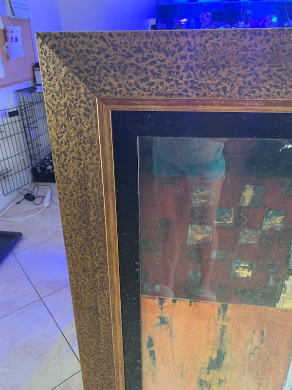 Gold frame and glass panel 3f7a2766-c599-46bc-9e4a-754766645190