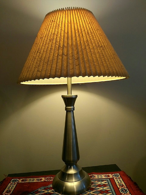silver metal table lamp  8bc4128c-0880-45e1-9b2a-39fa1aae1f20