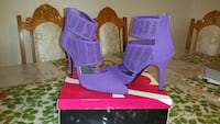 pair of women's purple suede ankle strap high heels with box