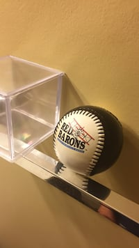 White and black Red Barons baseball with clear plastic case Leesburg, 20176