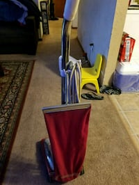 red sanitaire vacuum cleaner,l have 5 of em,cash o