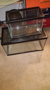 two black metal framed glass fish tanks 29 km