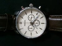 round silver chronograph watch with black leather strap Calgary, T2K 4Y9