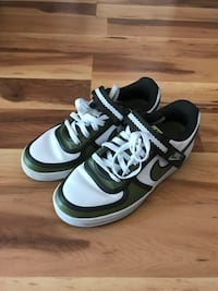 Green and white nike shoes  Reno, 89506