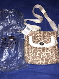 Authentic BNWT COACH GIRAFFE PRINT brown and white sling bag