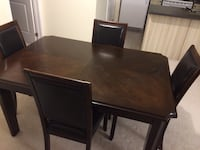 Brown wooden dining table  with 6 chairs. Oakville, L6H 0K7