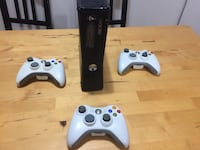 Xbox 360 with controllers + games Surrey, V3S 9C7