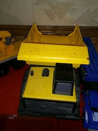 yellow and black plastic toy Spanish Fork, 84660