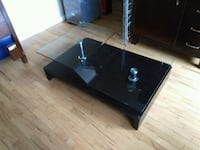 black wooden framed glass top TV stand Vancouver, V6J 3K3