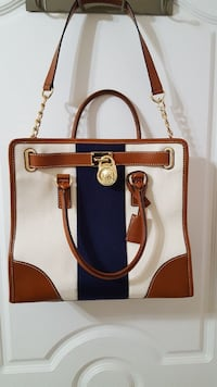 brown, white, and black Michael Kors leather handbag