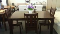 rectangular brown wooden table with six chairs dining set Houston, 77092
