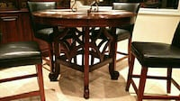 brown wooden table with chairs