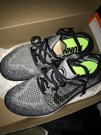 pair of gray-and-black Nike running shoes