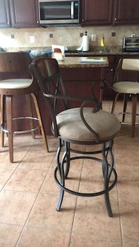 two black metal framed brown padded bar stools Baltimore, 21209