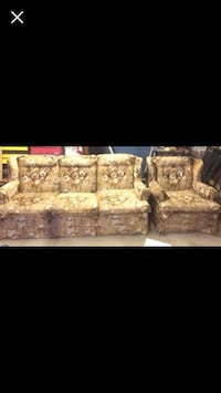brown and white floral fabric 3-seat sofa
